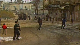 MG_021 Israel military footage: Gaza stock footage - Palestinian children throw stones at Israeli soldiers, 1998