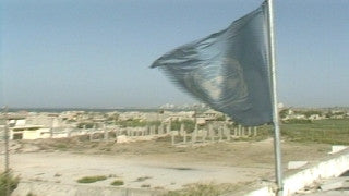 MG_032 Israel military footage: Gaza stock footage - Palestinian refugee camp with the sea in background, pan to UN flag, 1994