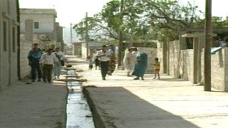 MG_033 Israel military footage: Gaza stock footage - Palestinians in the street with open sewage tunnel, 1994
