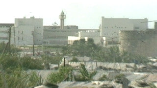 MG_038 Israel military footage: Gaza stock footage - zoom out from a mosque to shacks in a Gaza refugee camp, 1988