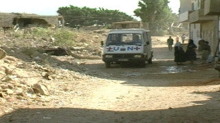 MG_043 Israel military footage: Gaza stock footage - UN van drives on dirt road in Gaza refugee camp, 2002