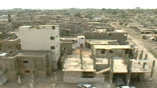 MG_045 Israel military footage: Gaza stock footage - zoom out and pan over houses and debris in Gaza refugee camp, 2002