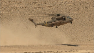 MI_002 Israel military footage: IDF military training - helicopter taking off in the desert