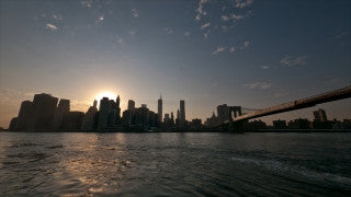 NY T4K 004 New York City 4K Time Lapse Footage: Slider shot of Brooklyn Bridge, East River, and Lower Manhattan at sunset