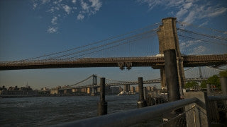 NY T4K 007 New York City 4K Time Lapse Footage: Slider shot of East River, Brooklyn Bridge, and Manhattan Bridge - crane up from water level