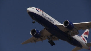 TR_009 Transportation in Israel: A BA airplane approaches landing in Tel Aviv Ben Gurion Airport, filmed from below