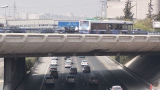 TR_015 Transportation in Israel: Fast motion car traffic on Tel Aviv Ayalon Highway