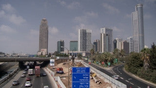 TR_016 Transportation in Israel: Fast motion car traffic on Tel Aviv Ayalon Highway and cross street