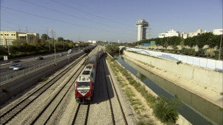 TR_023 Transportation in Israel: Fast motion cars and train on Ayalon Highway, Tel Aviv