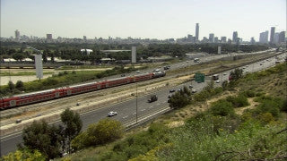 TR_024 Transportation in Israel: Pan right over cars and train on Ayalon Highway, Tel Aviv