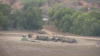 TZE_023 Israel military footage: Gaza War 2014 Operation Protective Edge - Loading a Merkava tank on a truck