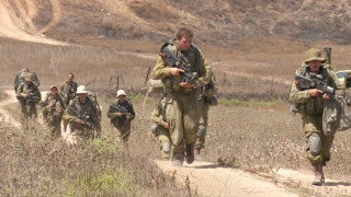 TZE_008 Israel military footage: Gaza War 2014 Operation Protective Edge - IDF infantry soldiers walking out of Gaza
