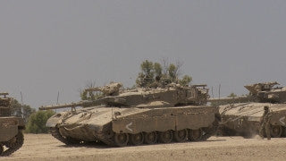 TZE_016 Israel military footage: Gaza War 2014 Operation Protective Edge - Trucks carrying tanks to the front