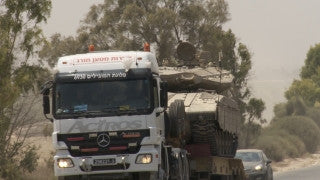 TZE_017 Israel military footage: Gaza War 2014 Operation Protective Edge - Trucks carrying tanks to the front