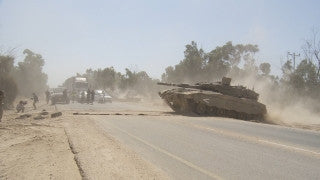 TZE_018 Israel military footage: Gaza War 2014 Operation Protective Edge - Tanks and armored carriers on the move