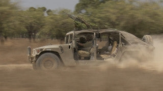 TZE_019 Israel military footage: Gaza War 2014 Operation Protective Edge - Humvee rushing along Israel - Gaza border