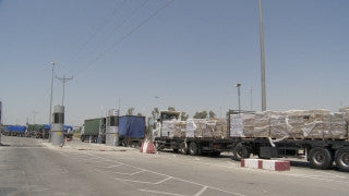 TZE_020 Israel military footage: Gaza War 2014 Operation Protective Edge - Humanitarian aid entering Gaza through Kerem Shalom checkpoint