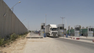 TZE_021 Israel military footage: Gaza War 2014 Operation Protective Edge - Humanitarian aid entering Gaza through Kerem Shalom checkpoint