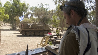 TZE_024 Israel military footage: Gaza War 2014 Operation Protective Edge - IDF soldiers resting and praying