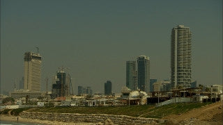 T_010 Tel Aviv stock footage: sunset in the sea over Tel Aviv skyline
