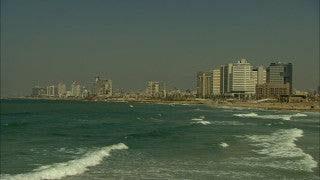 T_008 Tel Aviv stock footage: zoom out to sunset over Tel Aviv skyline