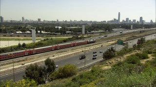 T_033 Tel Aviv stock footage: cars and train on Ayalon highway and Tel Aviv skyline