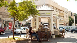 T_036 Tel Aviv stock footage: street cafe on Rothschild Boulevard and Allenby St.