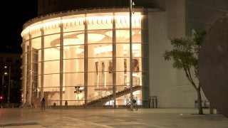 T_044 Tel Aviv stock footage: pan left over entrance to Habimah theatre at night