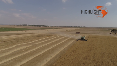 AGR_009 Agriculture In Israel: Combine harvest drone aerial - fast orbit
