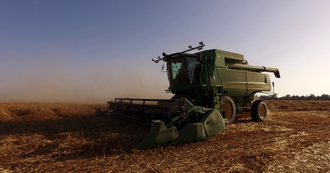 AGR_021 Agriculture In Israel: 4K video clip of hay harvest by a combine at magic light