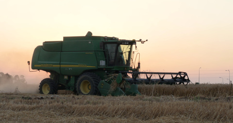 AGR_024 Agriculture In Israel: 4K video clip of hay harvest at sunset
