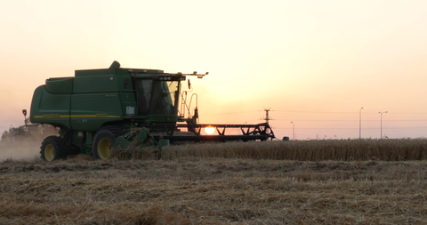 AGR_025 Agriculture In Israel: 4K video clip of hay harvest at sunset