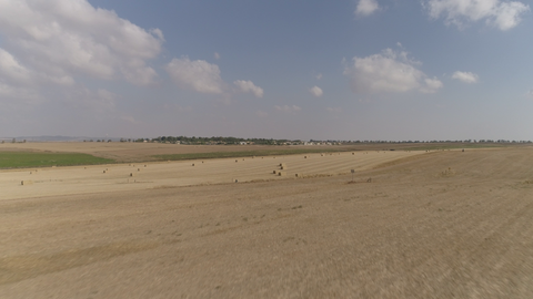 AGR_028 Agriculture In Israel: 4K drone aerial clip of fields after hay harvest