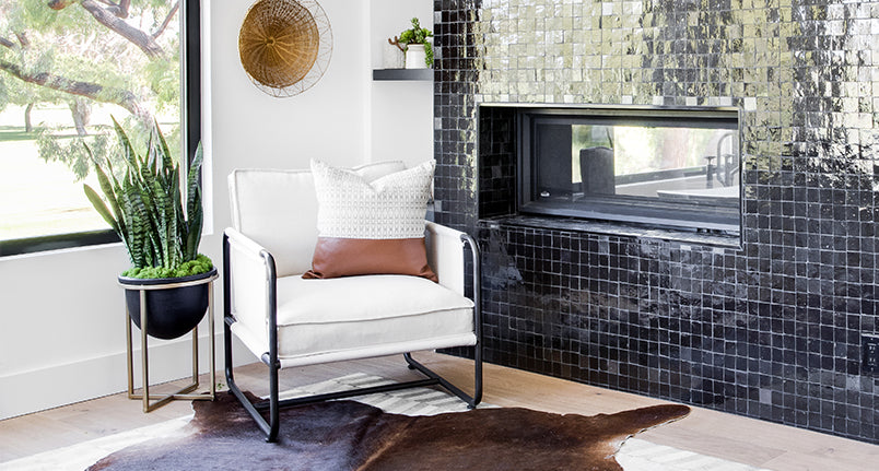Canvas lounge chair next to green handmade tile fireplace