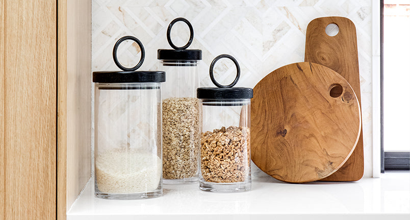 Kitchen storage containers and cutting boards.