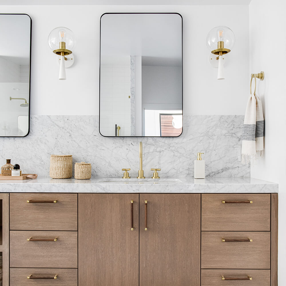 Mid-century meets California marble bathroom vanity with decor