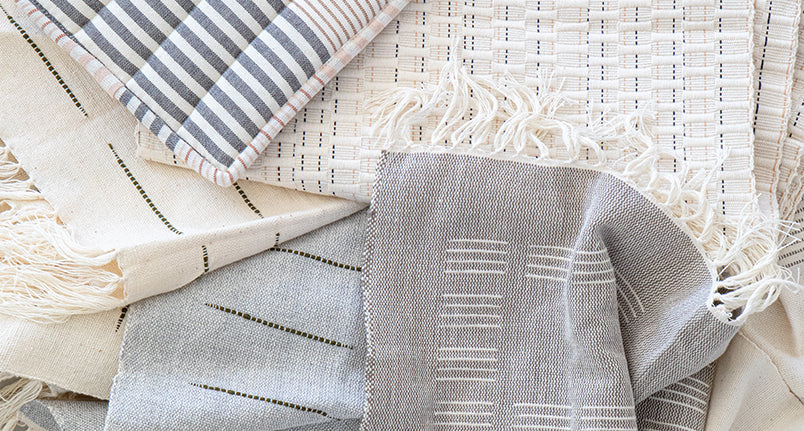 Various kitchen and dinging textiles layered on top of each other