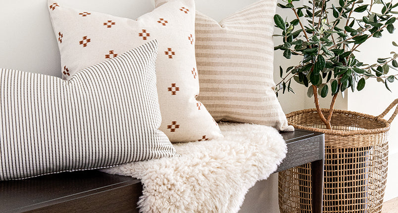 pillows and sheepskin on a wood bench