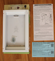Ideal box contents with instruction manual and pet door and warranty card