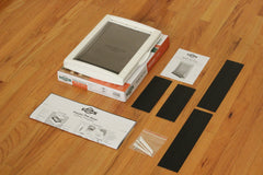 petsafe pet door coming with frame pieces, installation instructions, and hardware
