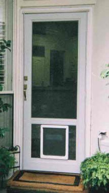 A Pet Door Installed in a Storm Door for dogs or cats. Great solution for a doggie door.