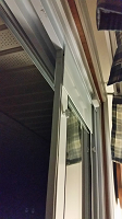 Top view of the Endura Flap Patio Panel Pet Door installed in a monorail patio door