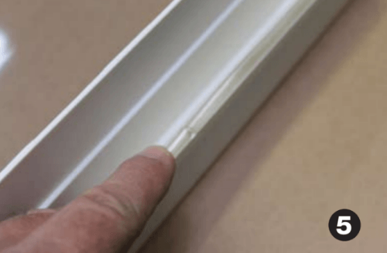 Complete by lining up gasket material at the bottom-center of the frame