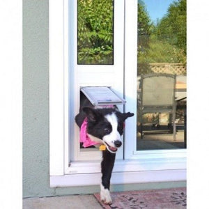 Black and white dog with a pink bandana happily coming out of the small endura flap thermo panel 3e