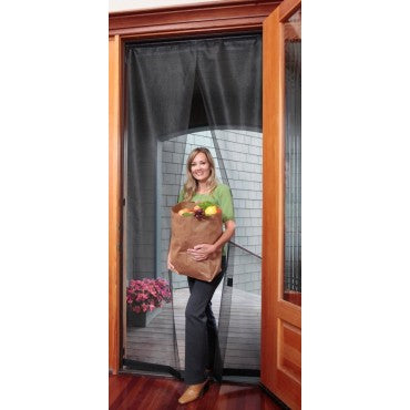 woman with groceries walking through bugoff hanging screen door