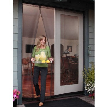 woman walking through bugoff hanging screen door