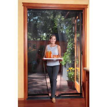 woman using bugoff hanging screen door