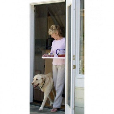 woman and lab using bugoff hanging screen door
