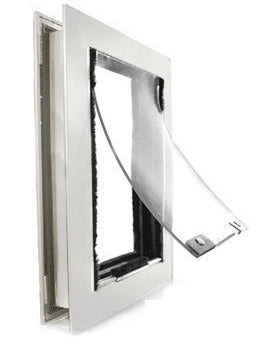A Hale Pet Door with a clear flap and a white frame lined with weather stripping