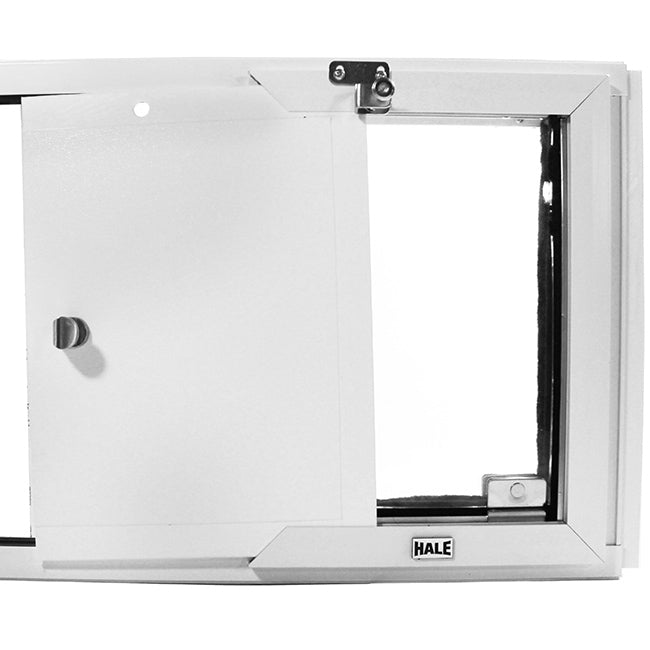 "The Hale ""Omni"" Pet Door for Sash Windows comes with a polyethylene locking cover that is shock and impact resistant"